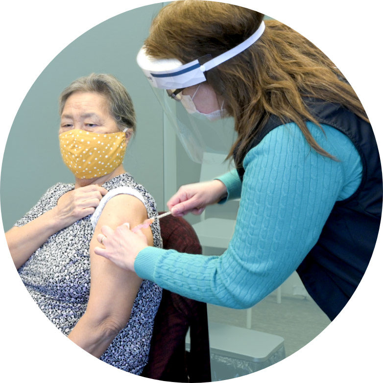 circle-woman-getting-vaccine